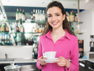 Cheerful Waitress In A Coffee Shop