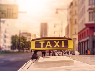 Taxi sign on top of a german cab in the evening sun, intentional